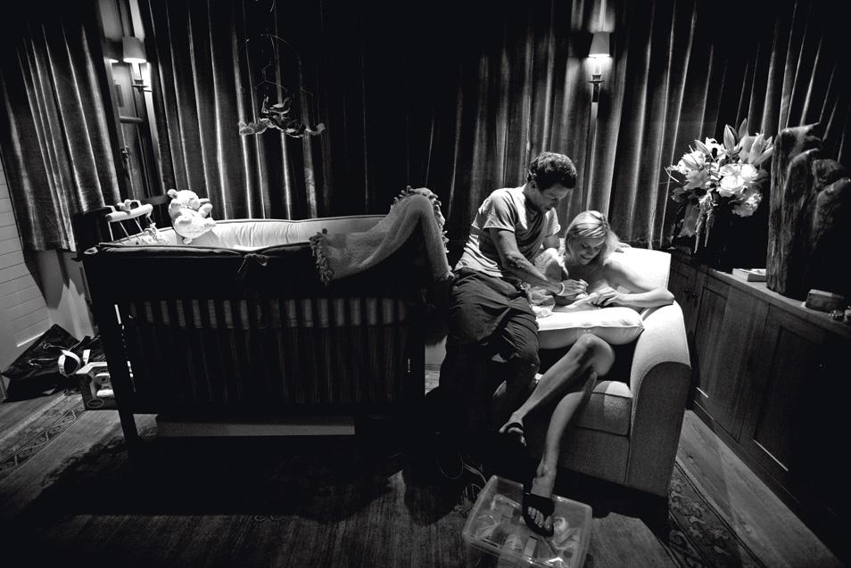 Armstrong comforts his girlfriend Anna Hansen as she nurses their newborn son, Max in his nursery at their home in Aspen, Colorado.