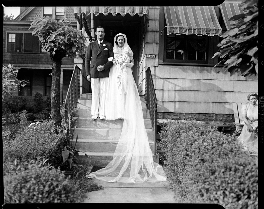 """Roland M. Sawyer and Aileen Eckstein Sawyer posed on their wedding day on steps of The Thimble Shop, 5913 Bryant Street, Highland Park"" by Teenie Harris © 2006 Carnegie Museum of Art,"