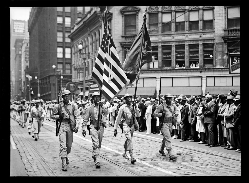 """Soldiers from the 372nd Infantry marching in parade, Fifth Avenue, Downtown"" by Teenie Harris © 2006 Carnegie Museum of Art, Pittsburgh"